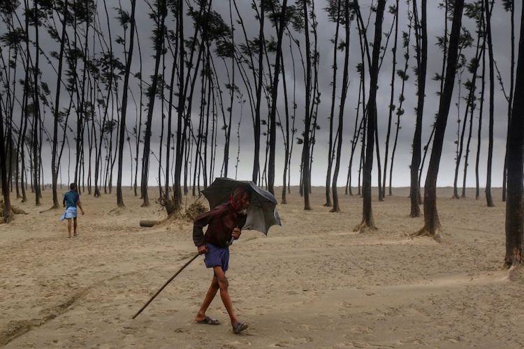 A Bangladeshi villager evacuates to a cyclone shelter on the coast ahead of Cyclone Mora on May 30, 2017