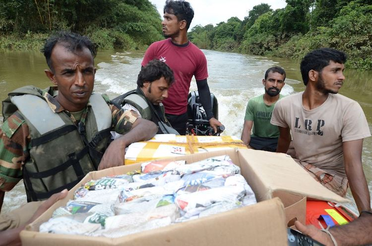 Sri Lankan Army personnel distribute food to flood victims in Molkawa in the district of Kalutara, Sri Lanka, on May 30, 2017.