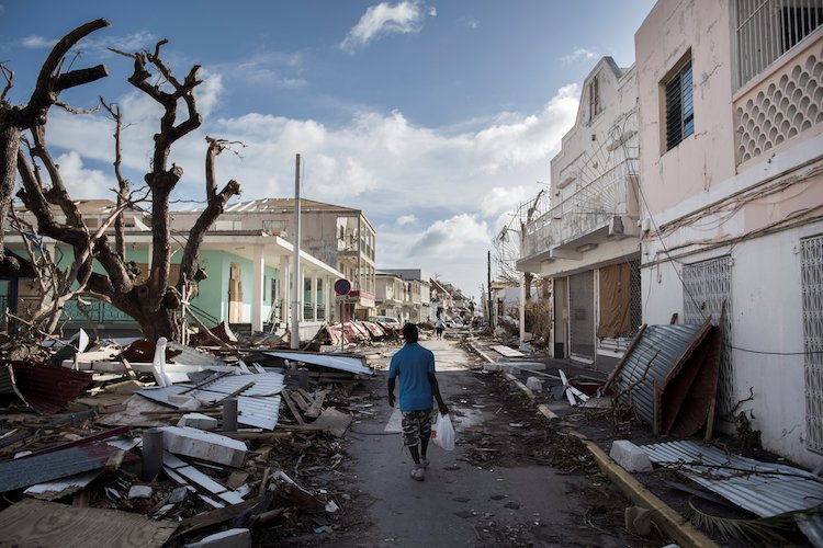 A man walks on a street covered in debris after Irma struck on Saint Martin,, 9/8/2017