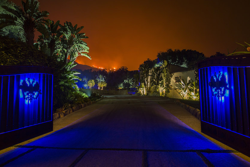 Glow of Thomas Fire behind home in Montecito, CA, 12/12/2017