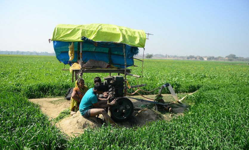 An Indian farmer prepares his pumping set to irrigate his wheat field on the outskirts of Allahabad on February 1, 2018