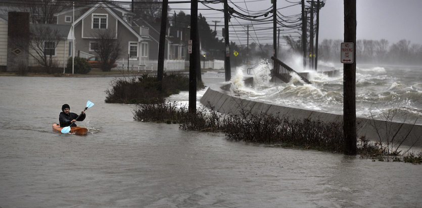 Kayaker on a flooded street in Quincy, MA, 3/2/2018