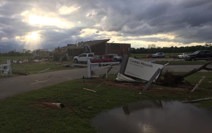 Damage to the visitors center (background) at the Caddo Mounds State Historic Site in east Texas from a tornado on April 13, 2019.