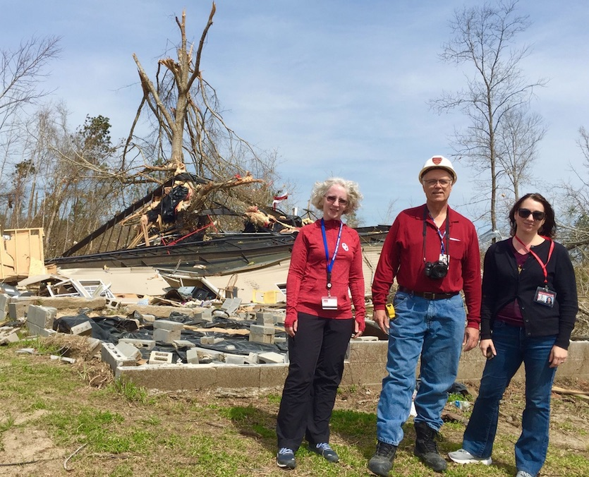 Tim Marshall, Daphne LaDue, and Lara Mayeux at one of the manufactured homes destroyed in Lee County, Alabama, by an EF4 tornado on March 3, 2019