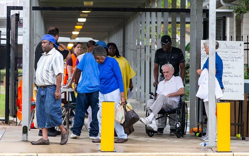 People arrive at a special needs shelter at Tallahassee's Florida High School on Wednesday, October 10, 2018, as Hurricane Michael approaches