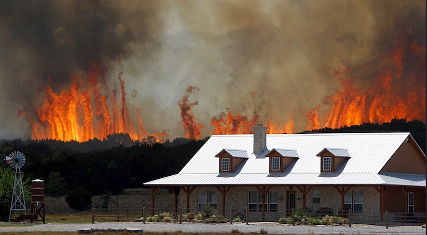 Wildfire threatens a home near Possum Kingdom, TX, west of Fort Worth, on April 19, 2011