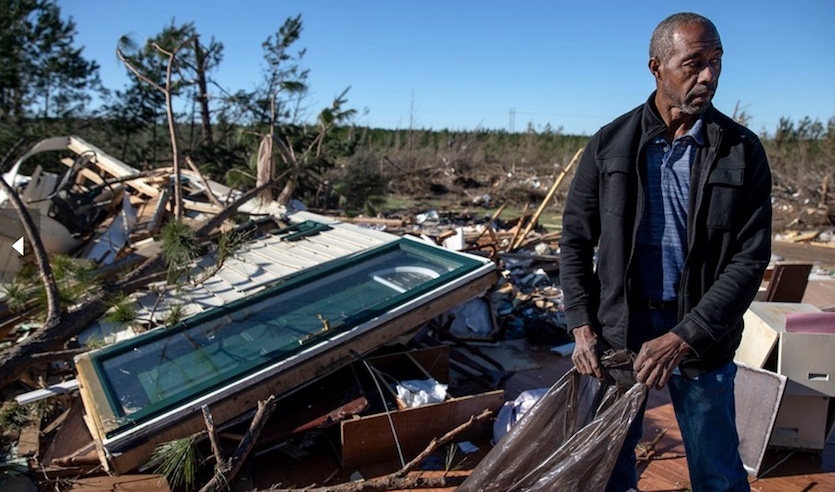On Tuesday, March 5, 2019, in Beauregard, Alabama, Richard Tate retrieves personal items from what's left of his home, where he survived a tornado with his wife on March 3