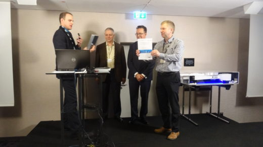 Mr. Klaus Olesen accepting his award for best presentation. Image courtesy of Dr. Ivo Weinhold. All rights reserved.