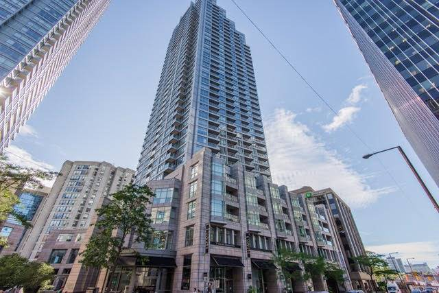 Not To Be Missed - Much Sought After - Highest Level Of The Flr Plan. Approx. 1200 Sq Ft Of Living Space 2 Bed, Den, 2 Full Baths, 2 Patios. Amazing Views To Lake, Cn Tower & Sunsets. Brazilian Cherry Wood Floors Throughout. Peach Glass Backsplash In Kitchen W/ Black Granite Counters & Black Marble Flrs. Amazing Views From Floor To Ceiling Windows. 2 - Patios Facing South West. South View Of Cn Tower & Lake Views Secured At This Level.
