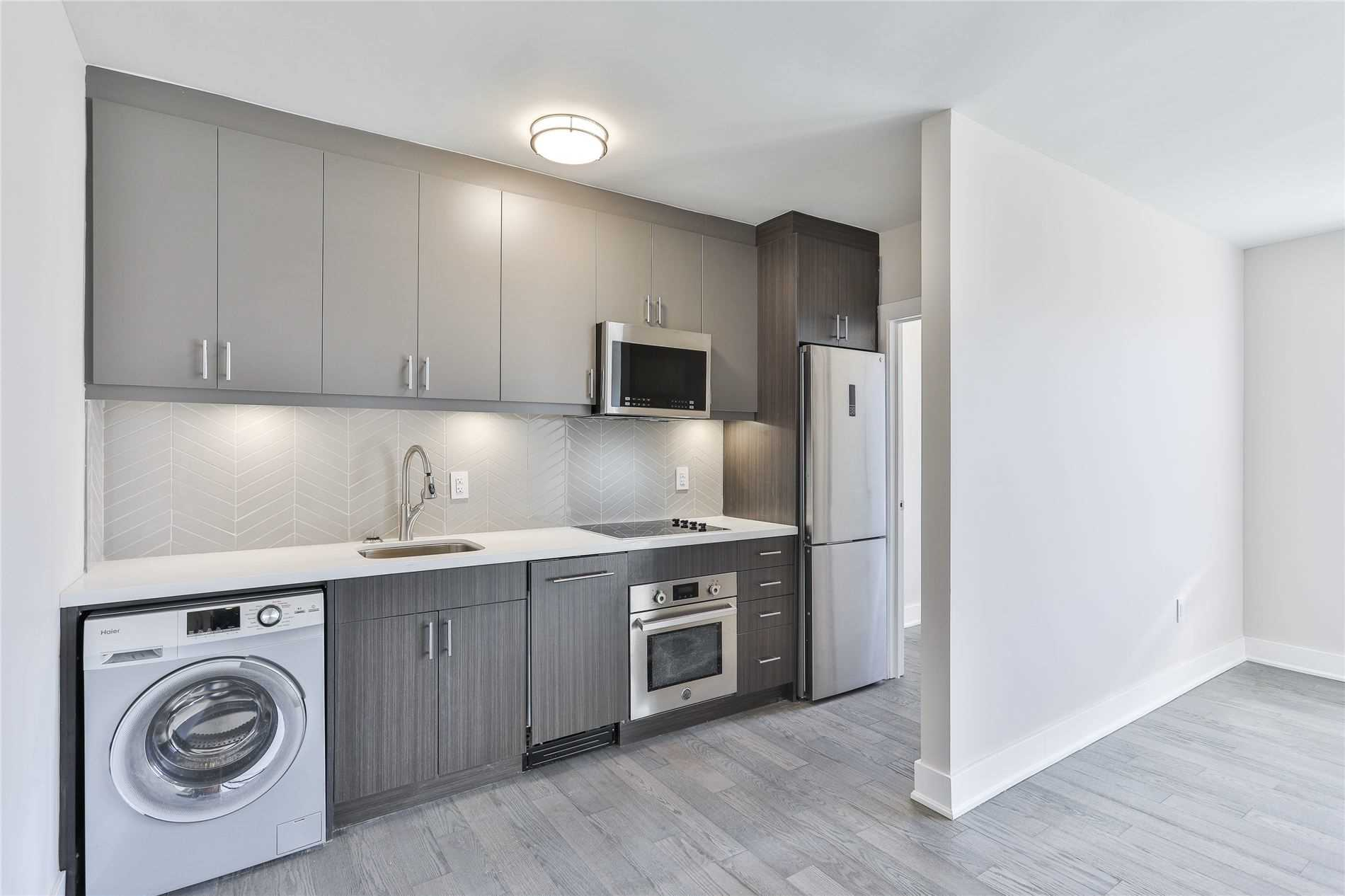Renovated And Redesigned Two Bedroom + Den Unit In The Heart Of Spadina Village. Minutes From Shops, Restaurants And Public Transit, Combined Living And Dining Room Space Provides Spacious Area For Entertaining And Family Living. Modern Kitchen With Brand New Appliances, Including Dishwasher And Combo Washer/Dryer, Master Bedroom Includes Walk-In Closet. Den Perfect For Storage Or For A Home Office. Abundance Of Natural Light Throughout The Unit.