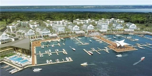 Welcome To Friday Harbour Resort! Brand New 2 Bdrm + 2 Bath Corner Unit,Approx. 850 Sq.Ft Of Living Space,Move-In Ready!Bright Unit W/Open Balcony,Partial View Of Lake.Gated Community.Steps To 1000 Boat Slip Marina,Beach Club,Boardwalk & Restaurants,Boutiques,200 Acres Of Nature Reserve W/Hiking,Biking,Walking Trails,18 Hole Championship Golf Course & Much More!