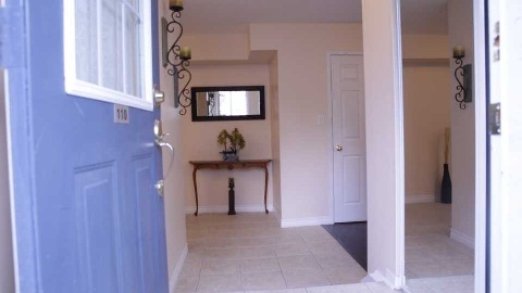 Don't Miss This Opportunity To Own A Well-Kept And Bright Corner Unit, Two-Storey Townhouse, Approximately 1290 Sf Of Living Space In Desirable Davenport Village. Master Bedroom With Ensuite Bath, Upgraded Closet Doors (Foyer) And Light Fixtures, Freshly Painted, Dark Laminate Flooring Throughout, W/O To Patio, Underground Parking, Minutes To Downtown, Steps To Ttc, Parks And Schools.