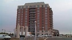 Excellent Location In Trendy Oak Park, This Beautiful Two Bedroom Condo Comes With An Exquisite Interior Layout. One Of The Most Preferred Buildings In The Area. Balcony Overlooks Outdoor Swimming Pool. 5 Min Drive To Beautiful Oakville Waterfront. Steps To Public Transit, Plazas, Shopping, Parks. Great Schools In The Vicinity! Parking Included!