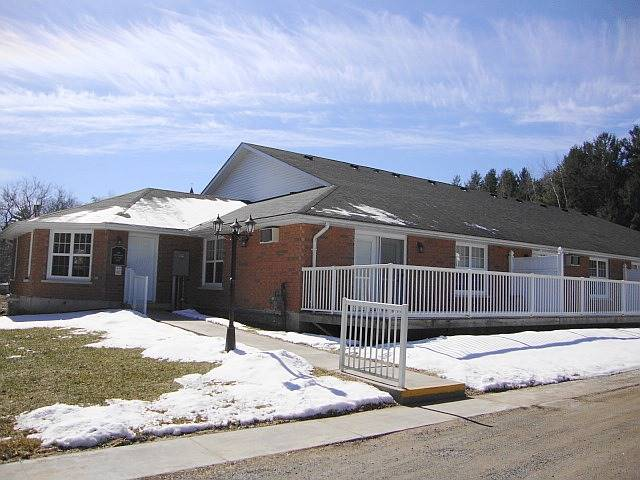 Why Not Retire In Tweed, Ontario?  Nice Building,  Open Concept Dining  Area & Living Room W/Garden Door To Deck And Laminate Floors; 2 Bedrooms; Main Floor Laundry; Neutral Decor; Covered Parking Space. Great Complex. All Utilities Are Included In Monthly Condo Fee $431.06. Wheelchair Accessible, Common Room, Sitting Area With Fireplace, Easy To Show, Immediate Possession Possible..