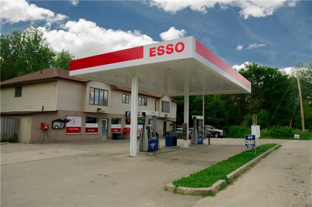 Location, Location Location! Rare Opportunity. Esso Branded Gas Station With Property In A Prime Location. Only 20 Mins North Of Vaguhan.  Great Frontage. Loads Of Potential. Just Off Hwy 400. Developing Area. Good Volume And Store Sales. Priced To Sell Fast. Includes 4-Bedroom Apartment Above Store With Potential To Rent Out For Additional Income. Great Fuel Supply Contract = High Margins On Gas. Don't Miss Out!