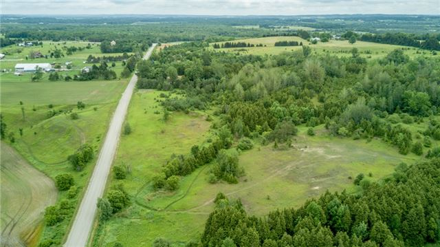 Fabulous Corner 64 Acre Property In Adjala Township With Views For Miles. Build Your Dream Home. Mostly Treed Property. Views All The Way To The Escarpment.