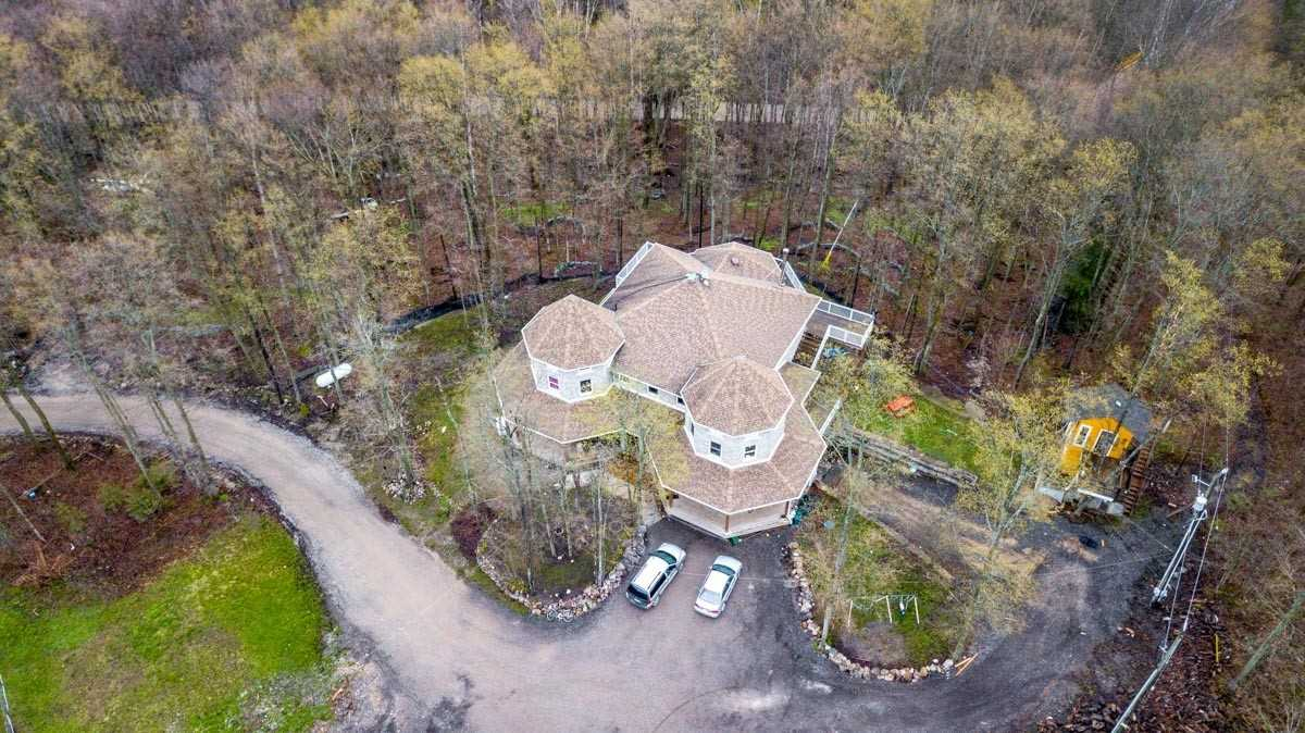 Looking To Invest Your Money? This Stunning Custom Built House On 47.5 Acres Of Forest. Must Be Seen! The Property Is With Very Successful Business, With Very Good Cash Flow According To Seller. Check Out The Paintball Fields, Pond, Trails And The List Go On!!!