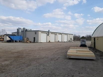 Rare Opportunity -  2.548 Acres Of Multi-Use Industrial Land - 80'X115' Heated Steel Building W/ 350 Sq. Ft. Ac Office And Four Drive Though Bays W/ Eight 12'X14' Overhead Doors, 16'X52' Drive Through Paint Booth -  45'X60' Outbuilding With Vinyl Roof. Three Main Reasons To Buy: 1) Built And Used As A Truck Body Shop 2) Many Legal Uses Incl. Open Storage. 3) Negotiable Tractor Dealership Business License And More. See Enclosed White Paper For More Details.