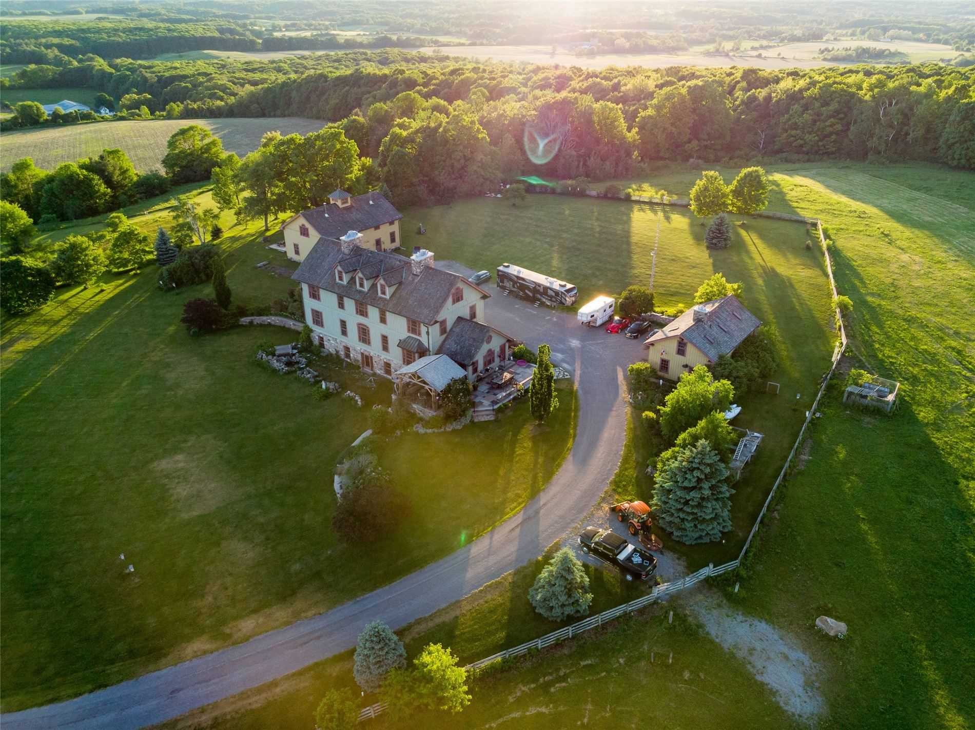 'Longview Estates' Is Truly A One-Of-A-Kind Retreat That Offers Unrivaled Privacy & Breathtaking Views Of Rice Lake, Rolling Hills Backing Onto Ganaraska Forest. Perfectly Sited Atop One Of Northumberland's Highest Hills, This 100 Acre Estate Boasts An 8500Sq Ft. Custom Colonial-Style Home, 3400Sq Ft. 2-Storey Coach House W 1800Sq Ft. Guest Quarters & Cupola, Det. 3-Bay Grg W Fin. Loft Space, 6-Stall Equestrian Barn & Multiple Outbuildings. Custom Everything!