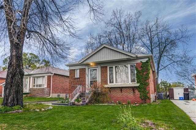 Well Maintained Large 3 Bedroom Bungalow On Quiet Street With A Lovely Backyard Backing Onto Manhattan Park Playground.  Long Private Drive With Parking For Three Cars.  Separate Side Entrance To The Large Basement With High Ceilings.  Schools: Manhattan Park Jr Ps, Buchannan Ps, Wexford.