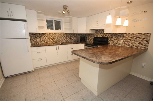 Spacious 2 Bedroom Basement Apartment. Very Clean, Renovated & Ready To Move In. Large Open Concept Living, Dining And Kitchen With Breakfast Bar. 4 Piece Bathroom. Separate And Private Laundry. Private Entrance. 1 Surface Parking Spot. Located Close To Eglinton Go, Ttc, Shopping, Groceries & More! Move In Anytime.