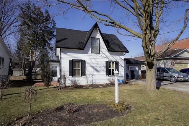 Located In The Heart Of Port Perry! Spacious 1 1/2 Storey Century Home Offers 2 Full Kitchens, 3 Bdrms (One On The Main Floor), Separate Living And Dining Room; Laminate & Tile Floors. Multiple Walk-Outs! Mature Treed Property Backing Onto Creek. Partial Finished Bsmnt Offers Rec Rm & Office. Walking Distance To School, Park, Restaurants, Shopping And Lots More! Ideal For Any Home Business!