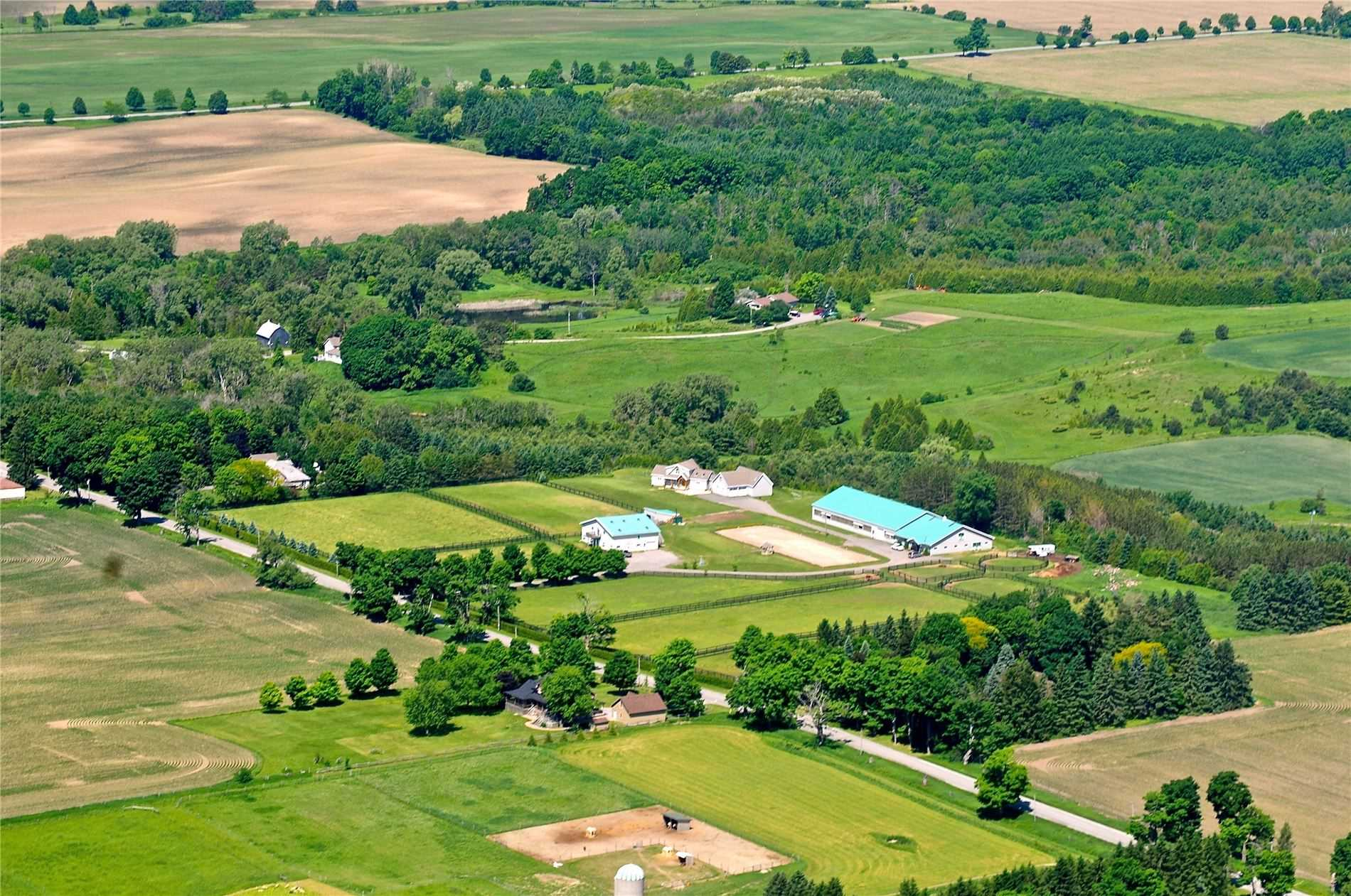 Only 10 Minutes From The 407, This Property Offers The Best Of Both Worlds With A Rural Lifestyle And Access To Toronto In Under An Hour. Situated Behind A Towering 8' Hedge & Roadside Gates Is An Equestrian Layout Ideal For Both A Private Or Boarding Facility. Impressive Main Dutchmaster's Barn With Arena Includes German Fibre Footing. Second Barn With Additional 8 Stalls, Garage & Spacious Finished Loft. Outdoor Ring With Drainage. Several Paddocks.