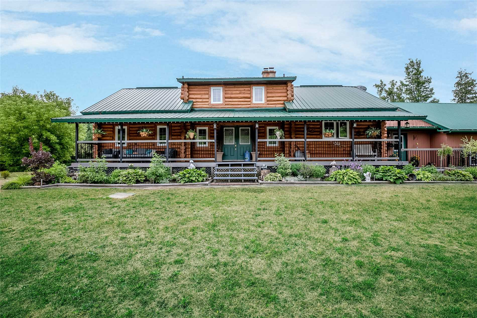 Discover The Timeless Style And Beauty Of This Custom Built Log Home With Steel Roof Located On 2.4 Acres Of Parklike Grounds. 3000 Sq Ft Of Spacious Open Concept Living, 4 Bedrooms, 4 Bathrooms, Fully Finished Basement, Soaring Cathedral Ceilings, Hardwood Throughout, Huge Eat-In Kitchen, Master Bdrm With Ensuite. Multiple Walkouts, Beautiful Covered Front Porch And Rear Deck W/Pool. Guest Log Cabin 12X16 With Electricity. The Feature List Is Endless!