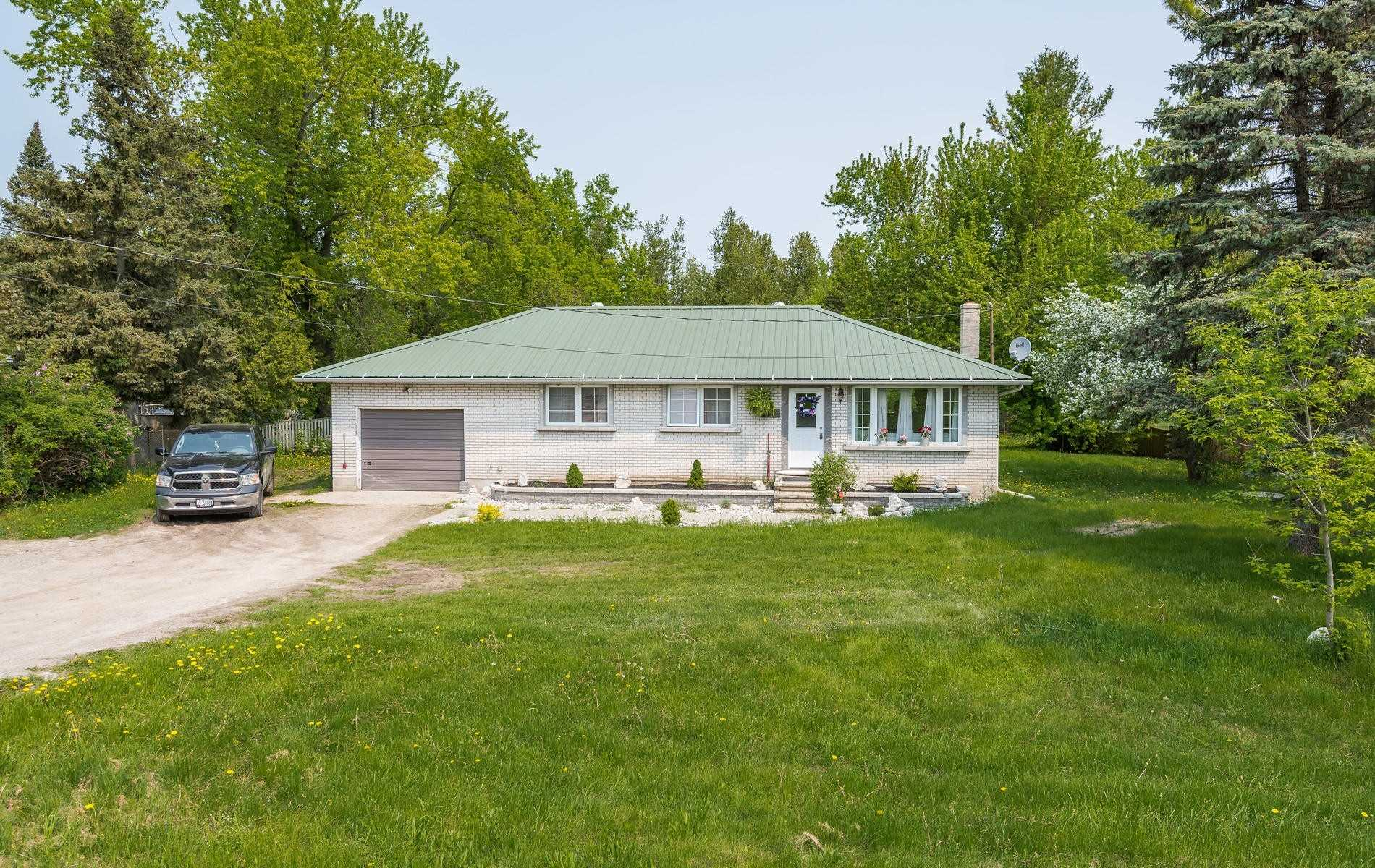"""Country Living At It's Best, Close To Town And Honda Plant, Half Acre Lot With Separate Entrance Apartment.  Unique One Of A Kind Wood Finishes.  Hiking Trails At The Back Of The Property.  Enjoy Your Ski-Doo. 4-Wheeler Out Your Back Door.  Metal Roof And Lots Of Parking.  Fiber-Optic Available To Work From Home. """"Seller Does Not Warrant Retrofit Of House"""""""