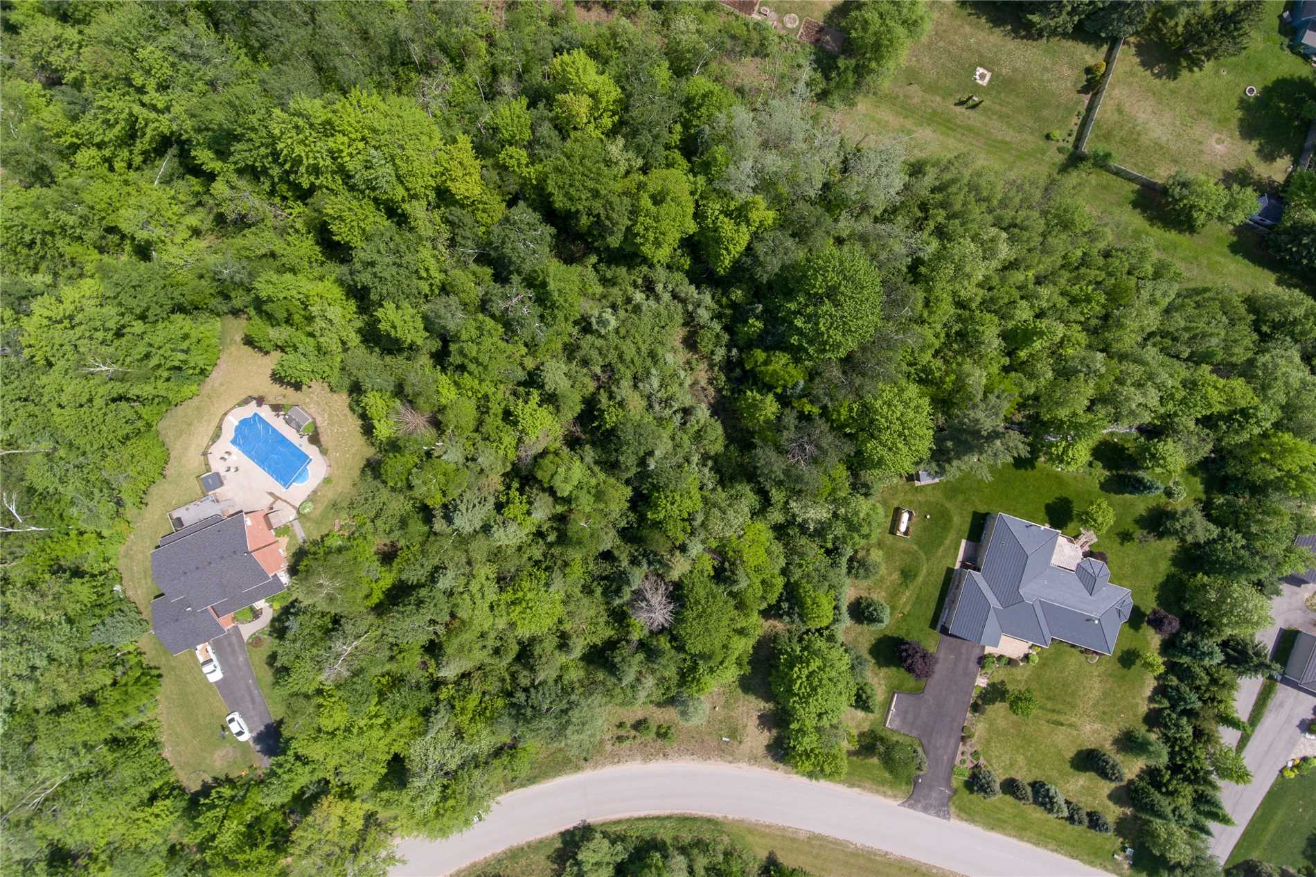 **Amazing Opportunity** Fully Treed 2.5 Acre Pie Shaped Lot In An Established Golf Course Community (Silver Brook Estates!) Build Your Dream Home On One Of The Largest Treed Lots Next To Million Dollar Homes & Estates. Rare Building Lot Opportunity To Build An Estate Home In An Established Community & Not Have Years Of Construction To Contend With, Minutes To Alliston & Camp Borden & Less Than An Hr North Of Toronto--Great Place To Call Home, Don't Miss Out!