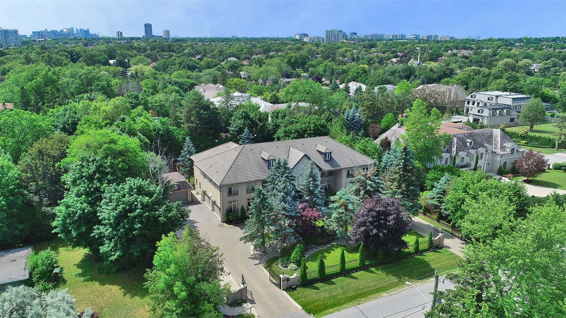 Spectacular 150 Ft Wide Lot With 10,000 Sq. Ft. Estate With 6 Car Garage In One Of Thornhill's Most Prestigious Neighbourhoods! ~ Mezzanine O/Looking Grand Foyer, *** Elevator*** , Enormous Master W/ Sitting Room, W/O To Terrace Overlooking Swimming Pool & Magnificent Gardens, 2 Walk In Closets, Ensuite & Sauna. This Grand Home Is An Ideal Residence For Entertaining. +5,000 Sq.Ft. Basement Incld Rec.Rm + Bar,Disco + Bdrm.,Den, Home Theatre, + Steam Room