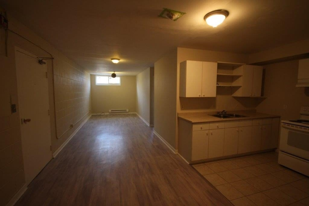 2 Br Lower Level Apartment Located In Back Of Plaza, Recently Renovated, Water Included, Heat, Hydro Extra, Share Coin Laundry.