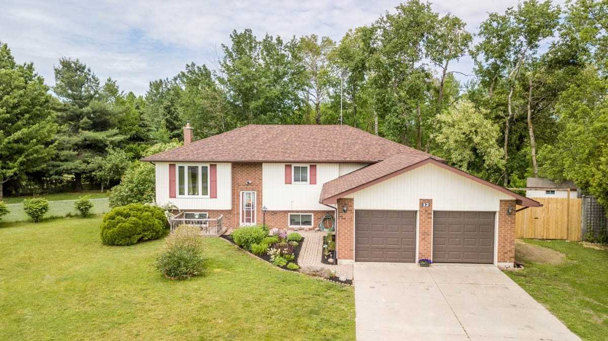 Family Home On A Beautiful Country Lot In New Lowell. Raised Bungalow W/ Bright Open Concept On Main Flr,  Liv/Din Rm, 2 Bedrms & 2Bth, Eat-In Kitchen W/ Lots Of Cabinets. You Can Bbq And Entertain On A 2 Tiered Deck Overlooking Huge Private Yard Backs Onto Green Space. Full Fin Walkout Basemnt W/ Large Family Rm, New Wood Stove, 2 Extra Bedrms & 4 Pc Bath. Attached 2 Car Garage, Double Concrete Drive. Country Living Close To Borden, Barrie, Alliston.