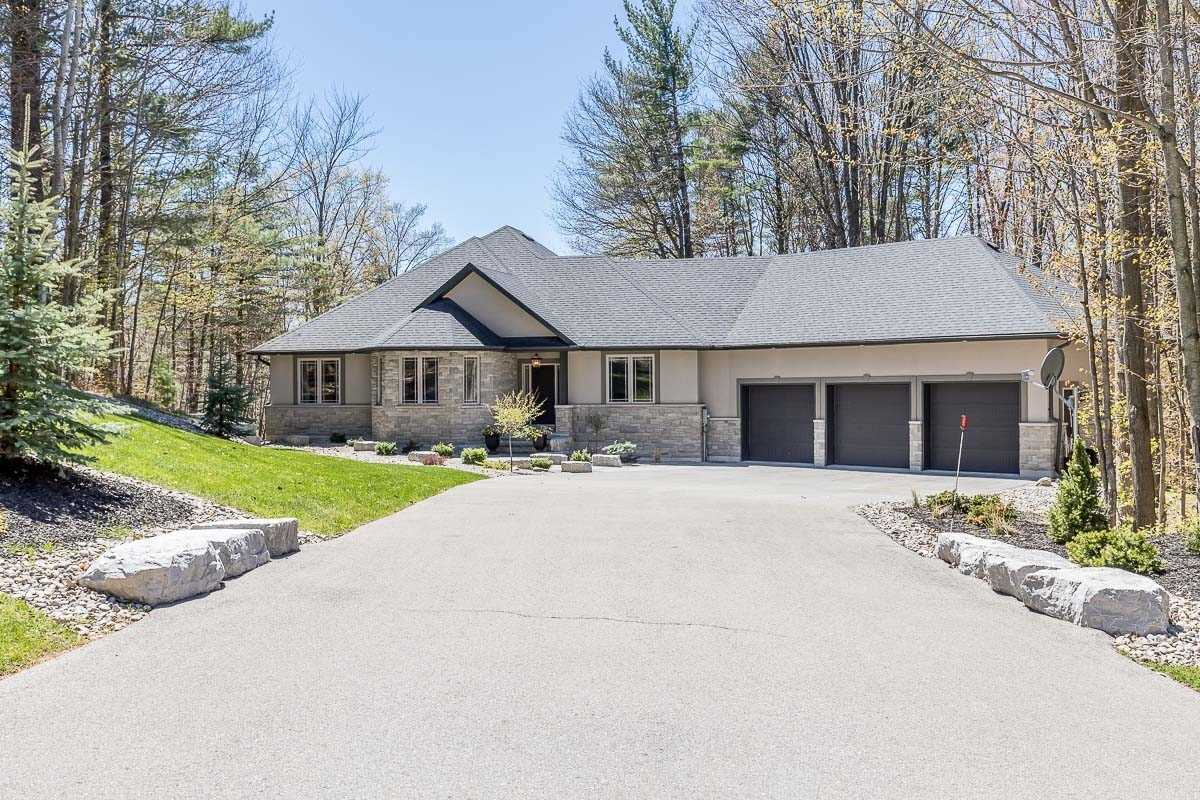Welcome To Apto Glen Estates,Beautifully Maintained Custom Built Icf Home On Just Over 1.5 Acres, Featuring 2346 Sq Ft Bungalow W/1800 Sq Ft Finished W/O Lower Level.Mn Flr Features3 Bedrms,3 Baths,Cathedral Ceiling Open Concept Mn Flr. Stunning Kitchen W/Island Overlooking Great Room W/Gas Fireplace & W/O To Deck.Main Flr Den.Access To 3 Car Garage Lower Level. Nanny/ In Law Suite W/2 Bdrm, 2 Baths,2nd Laundry,Separate Entrance. Excellent In-Law Set Up.
