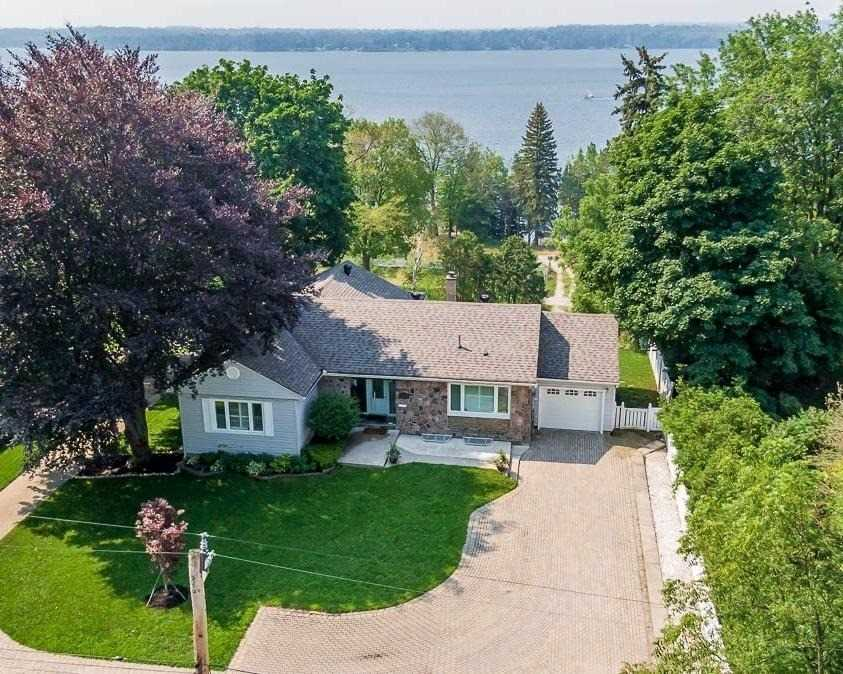 Welcome To The Prestigious North Shore Of Barrie.  Prime Waterfront Location With Breath-Taking, Panoramic Views Of Kempenfelt Bay.  The Main House Is A Beautifully Decorated Bungalow, Finished With Top End Features And Stunning, Large Open Concept Main Floor.   Two Beds On The Main Level Each With A Private Bath. Two Beds Downstairs With Full Bath, Large Family Room And Second Kitchen. Waterfront