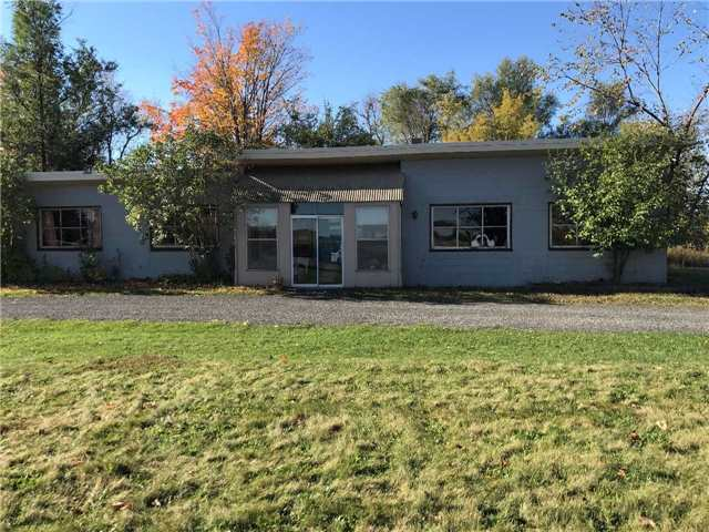 Great Location! Easy Access To The 401.  2 Acre Property Just South Of Acton Featuring 3 Garage Bays 12' High Plus An Additional Workshop Area. Attached To  The Shops Is A 4 Bedroom Home In The Rear. Lots Of Options With Renting The Garage Bays And/Or Residence. Lots Of Land For Parking,