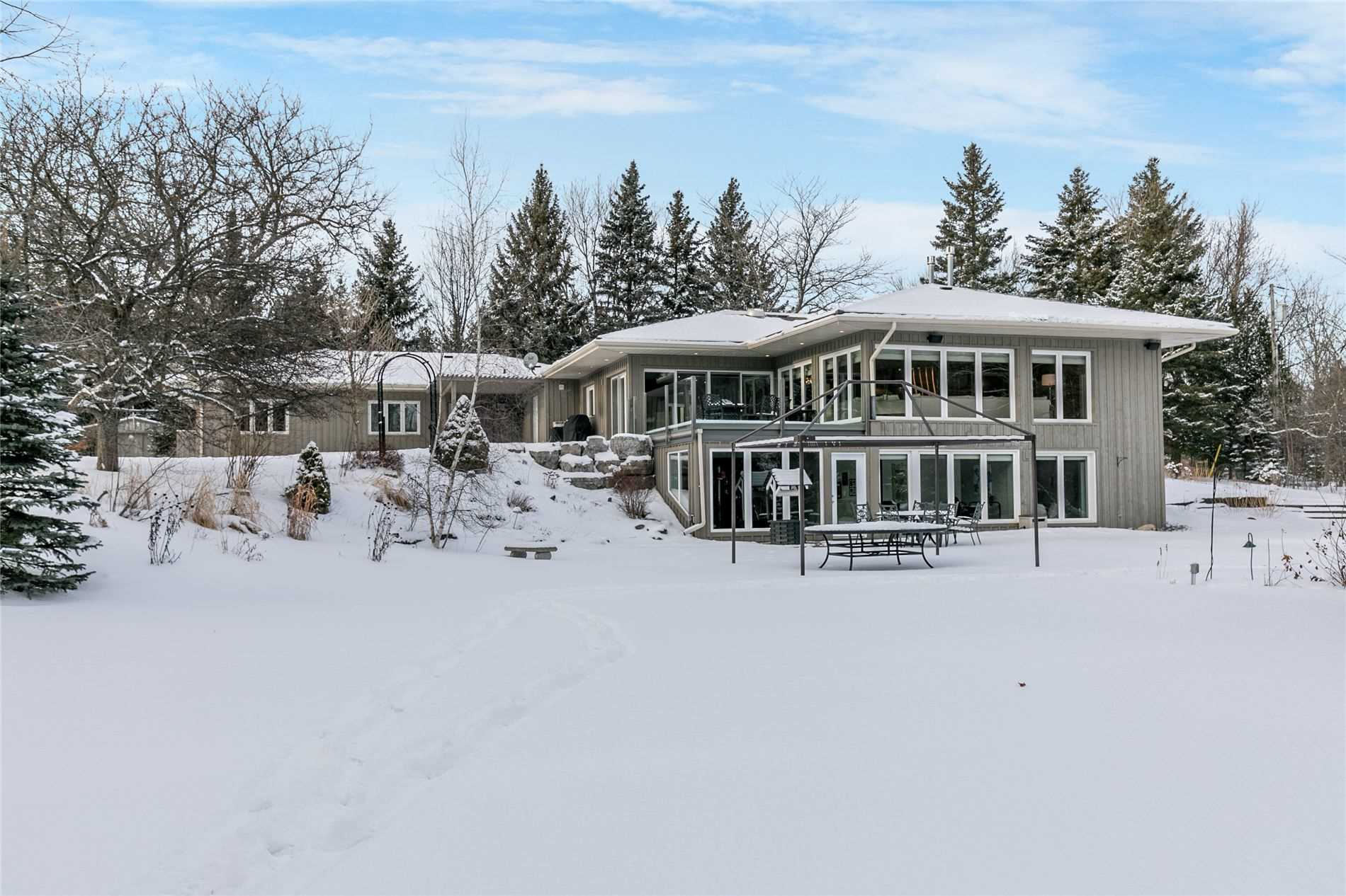 Rare Opportunity To Own 19.46 Pristine Acres In Caledon With The Credit River Running Through The Southend Of The Property And The Orangeville Golf Club A Short Walk Through Your Woods. Complete Privacy And Tranquility. The Main Home Is Stunning! Two Kitchens, Open Concept Design, Walk Out Basement. Separate Full Nanny/Inlaw Apartment With 2 Bedrooms.  Detached 3.5 Car Garage. Possible Chance For Future Severance. Great For Multi Generational Families,