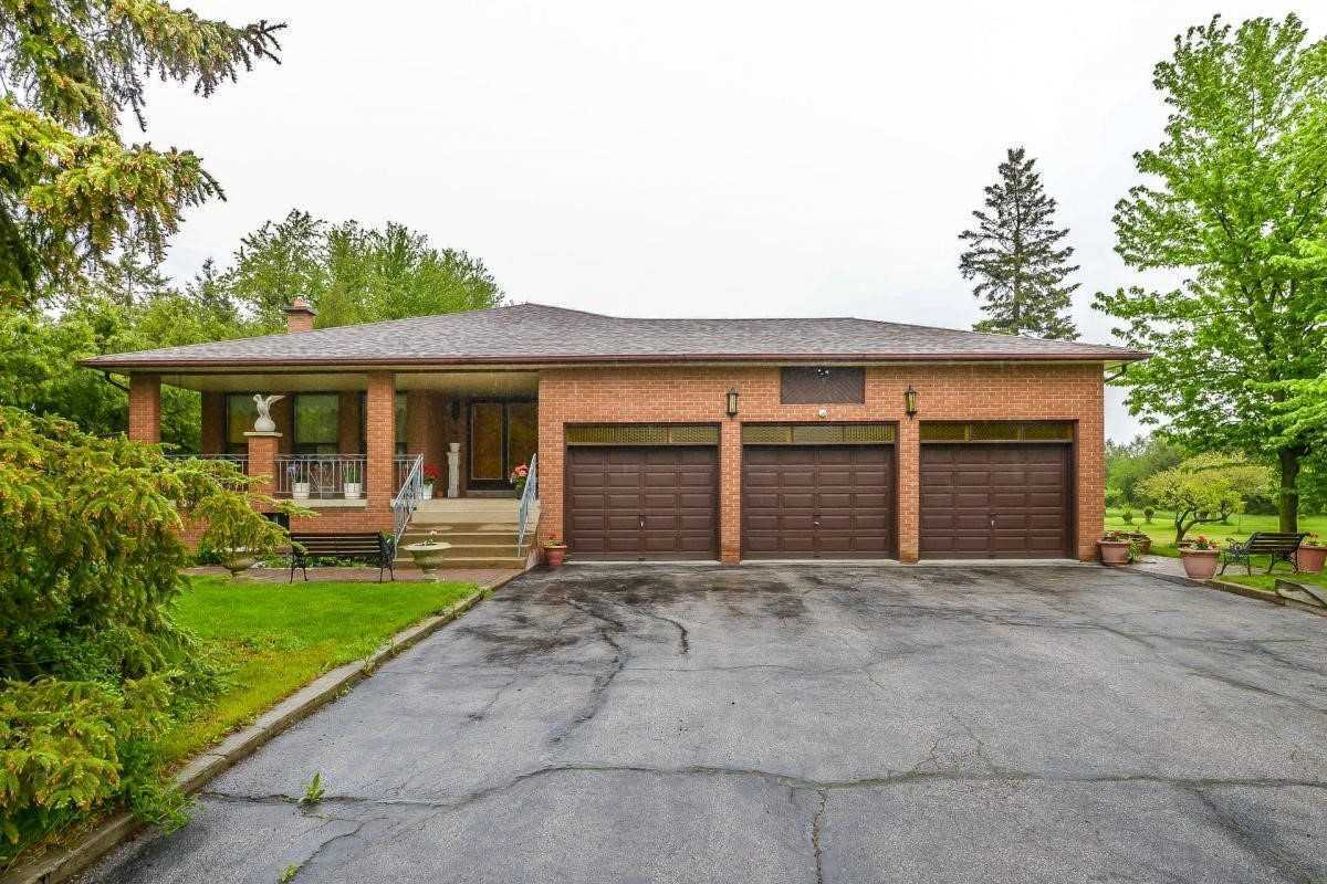 A Large 2.5 + Acres In The Pristine Rural Caledon Area! Extensive Driveway Fits 10 Cars + 3 Attached Car Garage W/ Access To Home. Eat-In Kitchen With W/O To Deck, Endless Yard & A Pizza Oven! Large Family Room Designed W/ Exposed Brick And A Gas Fireplace. Multi Side Entrances Make A Fine Layout. Possible 2 Family Home.Another Eat-In Kitchen In Bsmt W/ Side Entrance & Large Rec Space+Extra Rooms. Chicken Coop In Yard, Endless Possibilities & Opportunities...