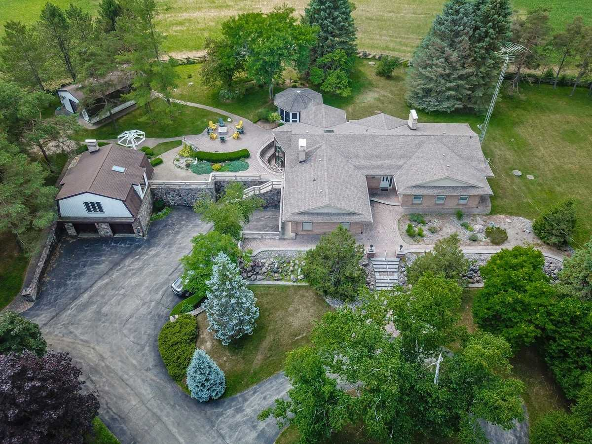 """Elegant, Peaceful And Secluded Country Estate, On 102 Acres *2 Road Frontage* W Views Of Rolling Cultivated Fields, Woodlands, Stream And Ponds! 4+1 Bed, 5 Bath Aprox 4500 Sq/Ft Luxury Living Space, """"Sprawling"""", Custom Built Bungalow W Many Updates. Granite Stone Walls,3 Fireplaces, Impressive Glass Atrium W Spiral Stairs. Separate 4 Car(Tandem) W 625 Sq/Ft Loft Studio Space Above. Drive/In Barn (4+Car). Mins To Guelph Line & 401. 30 Min To Pearson Airport.."""