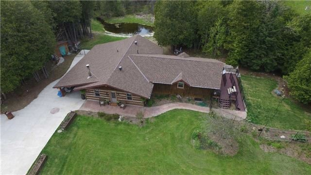 Attractive Country Home On 3 Acre Lot  Just Outside Of Chatsworth And Minutes To The Amenities Of Owen Sound & Georgian Bay Attractions. Not Your Traditional Sidesplit. Open Concept Main Level. Upgraded Kitchen & Bathrooms, Flooring, Windows & Doors, Deck, Eaves & Screened In Porch W/ Hot Tub. Home Is Heated W/ Wood Stove Plus New Wall Heat Pump. Spacious Mud Rm Entry Off Carport. Detached Garage/Shop (35' X24')