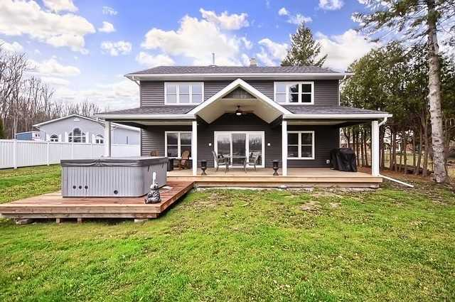 Beautiful Renovation-Bungalow Raised To Create A Fantastic 2 Sty. Huge Open Concept Living Area With 10Ft X 5 Ft Granite Island With Seating For 12. W/O To Covered Deck C/W Pot Lights And 6 Man Hot Tub. Corner Propane Fireplace And Heated Floors Make For A Cosy Living Space.Newer S/S Appliances, Pot Filler Faucet, On Demand Water System.Oversized Master With W.B Fireplace And  Views O/Looking The Trent. Luxurious Ensuite With Glassed Shower Featuring Steam,
