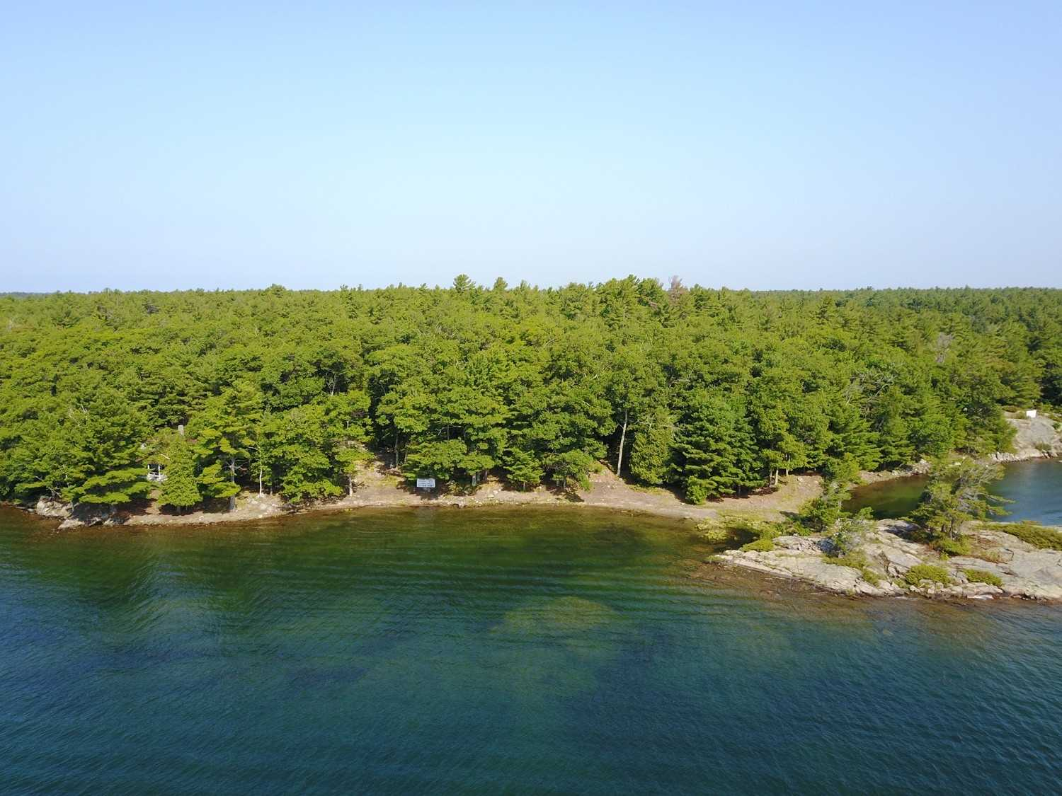 Vacant Island Lot 2.89 Ac, 455' Shoreline Water Frontage, 600'+ Lot Depth Into Champlain Monument Island. 1Km Paddle To The Famous Ojibway Club, In The Center Of The Island Community. 15 Min Boat Ride From Marinas. Short Walk Through The Woods To The Historic Champlain Monument. Views For Miles Onto Islands In The Exotic Georgian Bay Fresh Water Granite & Treed Pointe Au Baril Community. Hydro Next Door Or Solar Option.