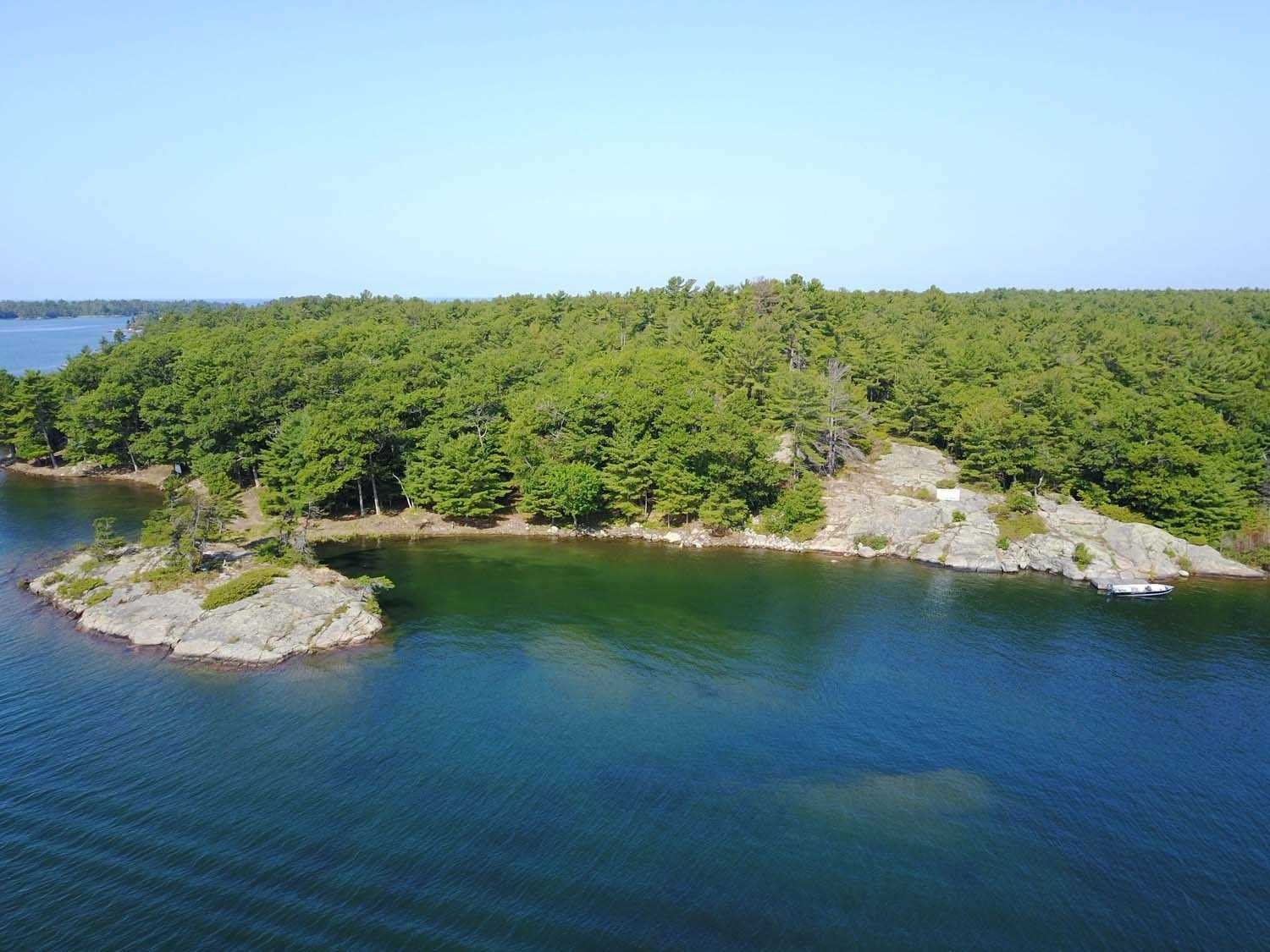 Vacant Island Lot 2.47 Ac, 855' Shoreline Water Frontage, 600'+ Lot Depth Into Champlain Monument Island. 1Km Paddle To The Famous Ojibway Club, In The Center Of The Island Community. 15 Min Boat Ride From Marinas. Short Walk Through The Woods To The Historic Champlain Monument. Views For Miles Onto Islands In The Exotic Georgian Bay Fresh Water Granite & Treed Pointe Au Baril Community. Hydro Next Door Or Solar Option.