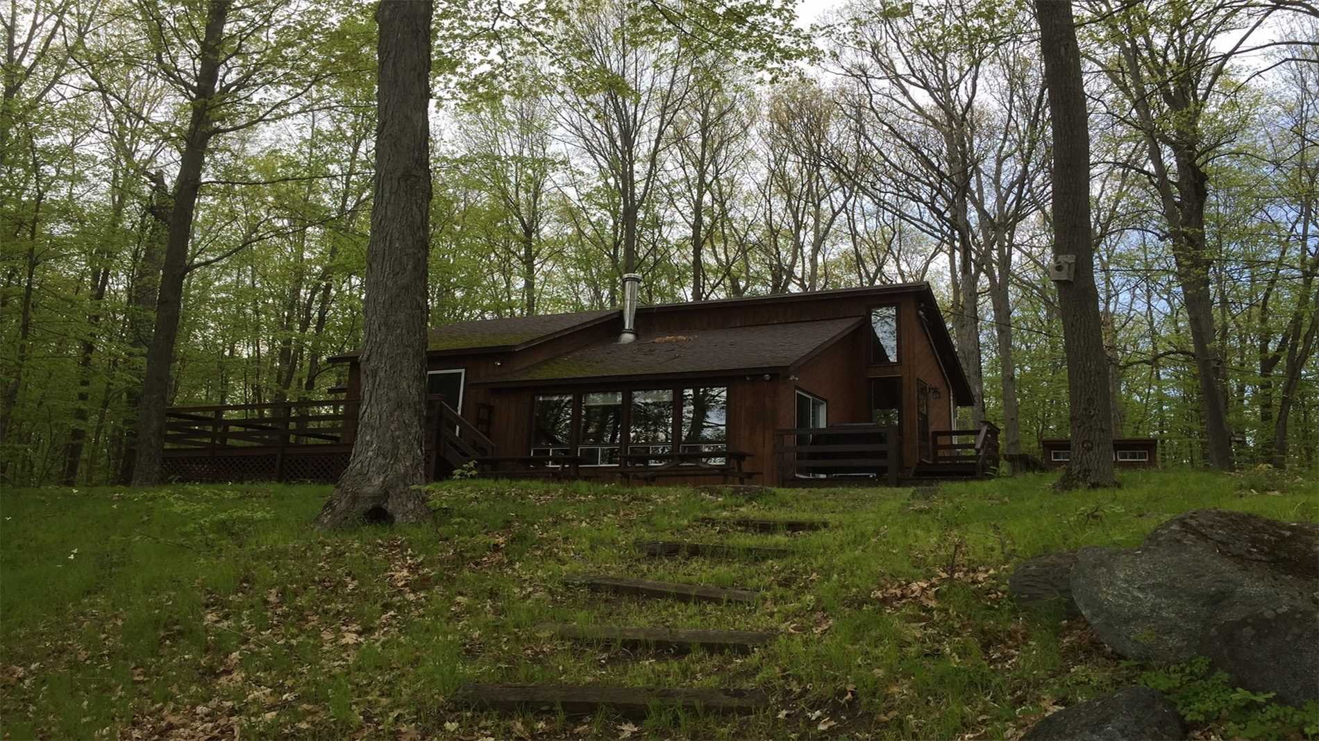 Waterfront Cottage Built 1982, 3 Bedroom, 1 Bath, Septic, Shore Well, Uv Water System, Full Year Private Road $300 Ann.  Large 2.25 Acre Lot, Large Treed With Boathouse And 2 Outbuildings.  Recently Upgrades Flooring & Bedroom Reno 2018.  New 40 Ft Floating Dock (2017).  585 Ft Waterfront On Crowe Lake, Marmora, Ontario.