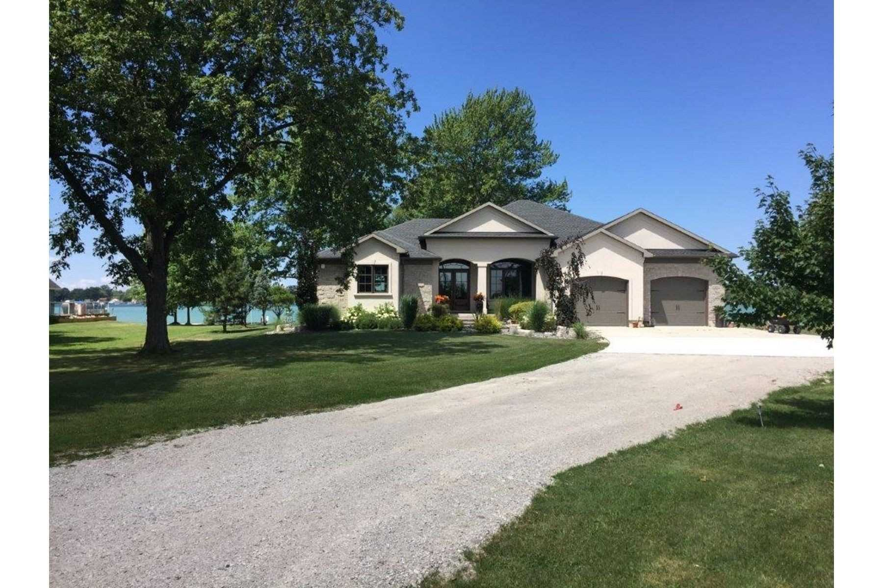 Waterfront Home On St. Clair River With 100Ft Of Water Frontage. This Quality Custom-Built Bungalow Is An Open-Concept Design With An Expansive Array Of Glass Throughout Offering Striking Views Of The River