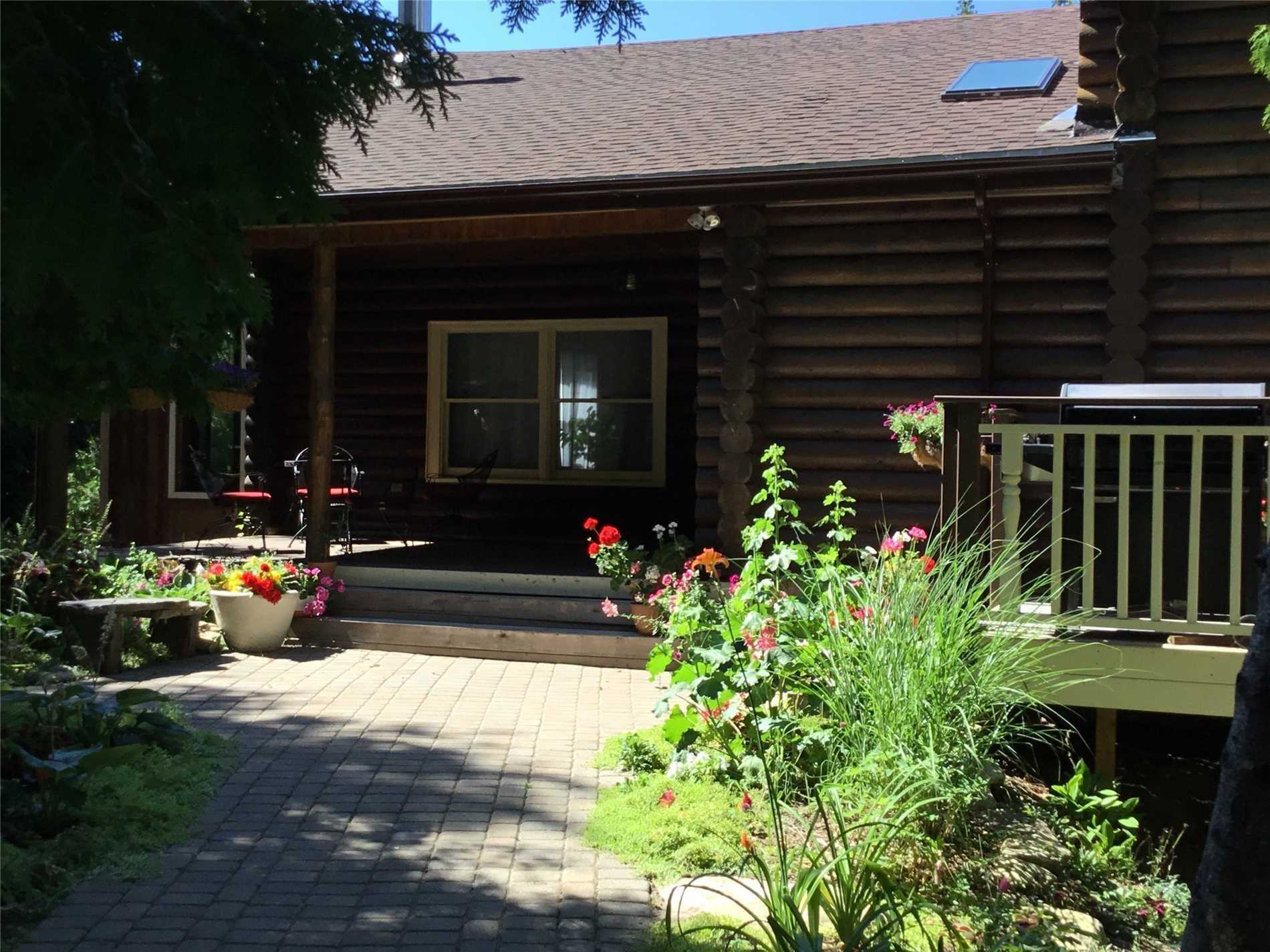 The Mature 3.3 Ac Forest And The Beautiful,Fully Updated In 2016 Log Home Offers Peace And Tranquility,Just 2 Minutes From Lake Huron Where You Can Experience The Famous Huron Sunsets ! New Roof, New Hardwood Floors, New Everything ! Partially Finished Basement With Separate Entrance, In-Law Potential.The 30X35 Great Room Boasts 16' Ceilings With Skylights,New Deck From Solarium. Successful B@B Business,Hike From Your Own Backyard, Nature Lovers Paradise!