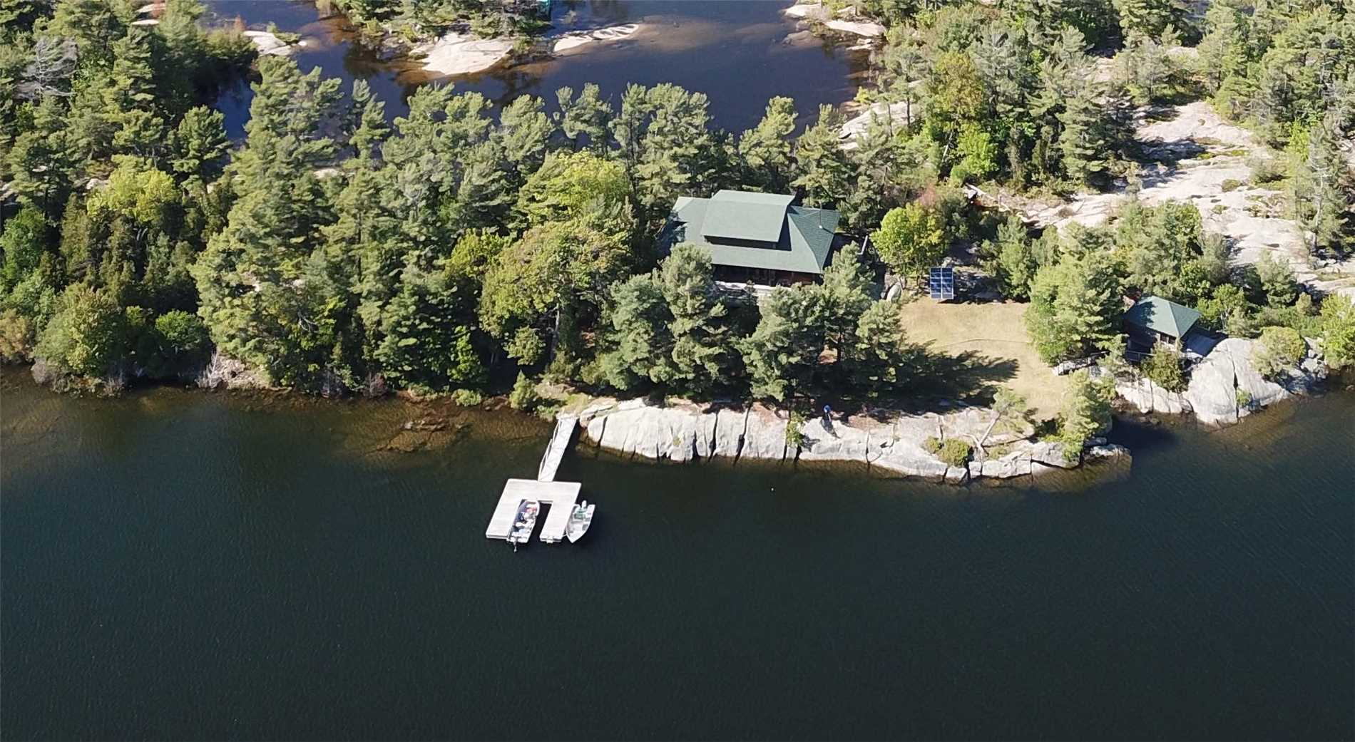 Newly Built 2008 Cottage By Stark Ireland Architects, Covered Porches, Decks & Views Across The Water To Undevelopable Natural State Shoreline In Private Oberlin Bay W/ No Boat Through Traffic. 1.3Ac Island In Pointe Au Baril's Georgian Bay Freshwater Granite & Pines Island Community, Famous Ojibway Club Close By, 15 Min Boat Ride To Marinas. 1 Bdrm Cabin On The Point W/ Washroom & Views From The Deck. At The Other End Of The Island, Find Posts For The