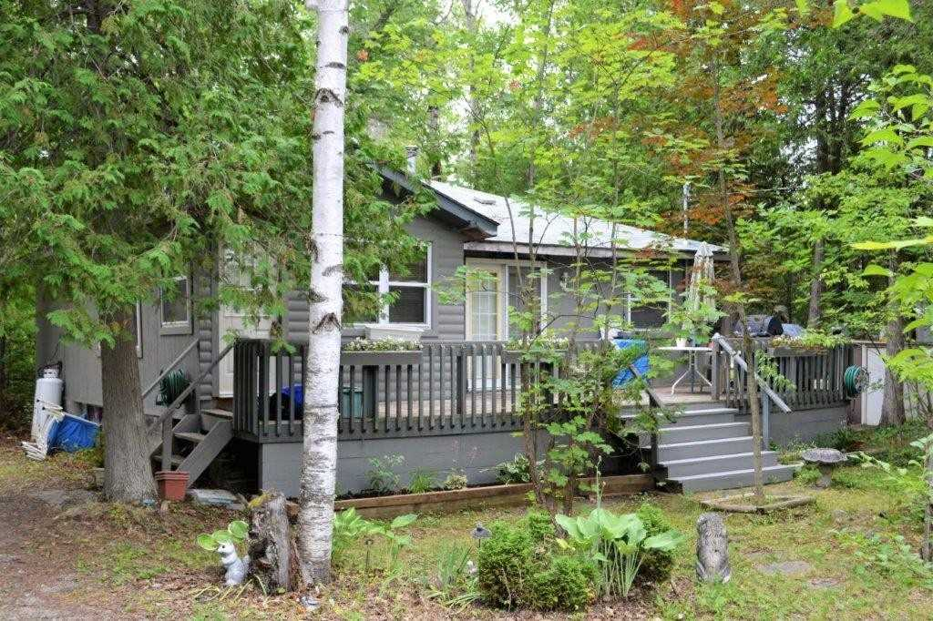Four Season Cottage 3 Bedrooms, 1 Bath. Access Steps Away To Sturgeon Lake. Private Large Lot, Year Round Road Access. Windows & Doors In Good Shape, Septic 10 Yrs Old, Roof 3 Yrs, Good Well. Large Storage Shed, Extra Storage Trailer On Site. Needs Some T.L.C. Easy Access To Bobcaygeon & Fenelon Falls. Most Furnishings Are Included.
