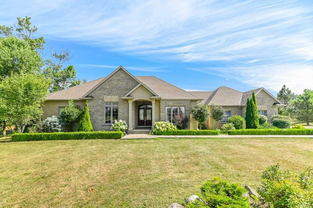 1.48 Acre Country Home Just 10 Minutes From Hwy 403. Custom Built Bungalow With Fully Finished Lower Level Totally Over 4,300 Sq.Ft. 3+2 Bedrooms; Master W/Spa-Like Ensuite Bath, Walk-In Closet & Hardwood Floors Throughout Main Floor. Kitchen With Custom Cabinetry, Granite Counters And S/S Appliances. Prof.Finished Basement With In-Law Suite Potential. Separate Detached Workshop With Heat & Hydro. Professional Landscaping, Stone Walkways & Rear Covered Patio.