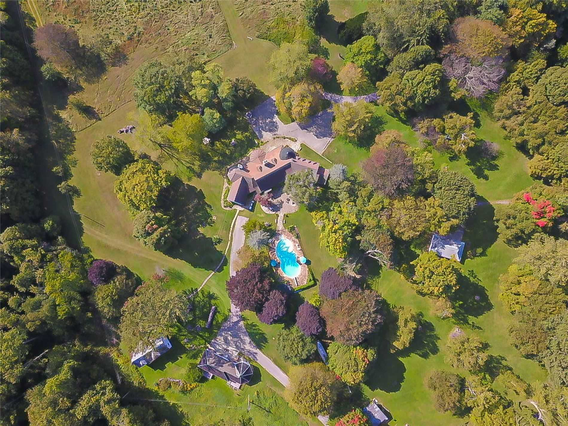 Introducing The Bayham Estates, An Exclusive 50 Acre Retreat Rising Up From Lake Erie's North Shore. This  Magnificent 7000 Sq. Ft Normandy Chateau Boasts 4 Bdrms, 5 Baths, Breathtaking Cathedral Ceilings, Hand  Carved Wood Panels Imported From France, Stain Glass Windows, 4 Stone Fire Places, Oak Floors, Salt Water Pool, Tennis Court, 10 Min Walk To  Beach.  5 Outbuildings(A Few Need Tlc.) Approx. 1.6 Km From Main Road. A Hidden Gem!